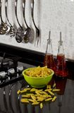 Background of modern kitchen and uncooked pasta Royalty Free Stock Photo