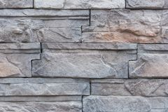 Background of Modern Slate stone Brick Wall Surfaced for design Stock Photos
