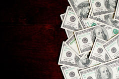Background with money. American hundred dollar bills on wooden desk stock photo