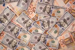 Background with money american hundred dollar and fifty euros bills. Royalty Free Stock Photos