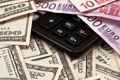 Background from money and calculator. Background from dollars, euro and calculator Royalty Free Stock Photography