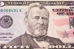 Background of the money. Fifty dollar bills front side. background of dollars, close up, Portrait of U.S. statesman, inventor, and diplomat Ulysses S. Grant as Royalty Free Stock Images