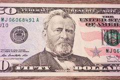 Background of the money. Fifty dollar bills front side. background of dollars, close up, Portrait of U.S. statesman, inventor, and diplomat Ulysses S. Grant as Stock Photos