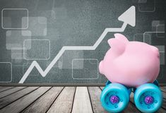 Piggy bank on wheels isolated on graph background. Background money object nobody close-up wealth box Stock Photo