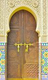 Background of Moroccan ornamental door. Al-hambra Moroccan palace detail architecture. The picture shows a beautifully decorated gate of the palace Royalty Free Stock Image