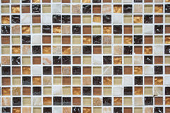 Background mosaic wall in brown, white, orange color. For copy space backdrop Royalty Free Stock Photography