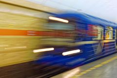 Background of motion blur of speed train in the subway. Underground vehicle dynamic motion. Stock Photo
