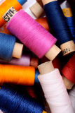 Background with multi color thread spools.  Stock Photography