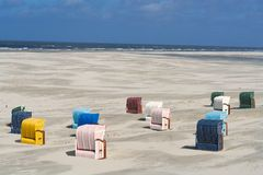 Background of multi colored beach chairs royalty free stock image