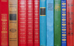 Background from multi-colored bindings of books Royalty Free Stock Images