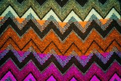 Background. Multi colored handmade knitted pattern Royalty Free Stock Image