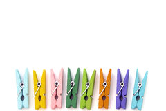 Background of multi colored linen clothespins Stock Photo