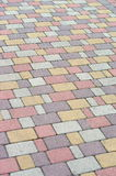 Background from multi-colored paving pavers Stock Images