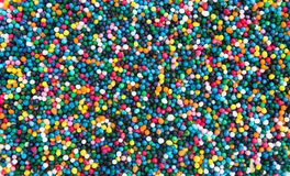 Background of multi colored sugar beads Stock Photo