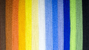 Background from multi-colored threads. A rainbow of thread. Royalty Free Stock Images
