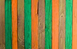 Background of multi-colored wooden boards. Color fence. Wooden texture Stock Photography