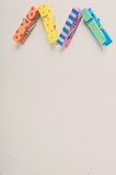 Background with multi-colored wooden clothespins with patterns zigzag Royalty Free Stock Photos