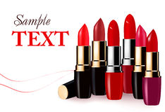 Background with multicolored color lipsticks. Stock Photos