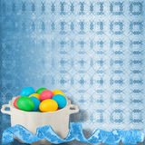Background with multicolored eggs in a bowl to celebrate Easter Stock Photos