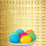 Background with multicolored eggs in a bowl to celebrate Easter Royalty Free Stock Photography