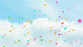 Background with multicolored flying balloons in blue sky royalty free stock photo