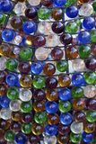 Background with multicolored glass spheres. Tied to a metal net Royalty Free Stock Image