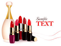 Background with multicolored lipsticks and perfume Stock Images