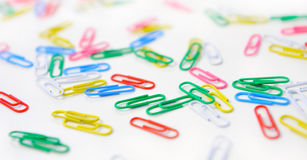 Background of multicolored paper clips. Stock Images