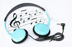 Background music with  blue headphones Stock Images