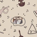 Background with music notes and instruments. Seamless background with music notes and instruments. Warm coffee tone. Beige background. Use as background or Royalty Free Stock Images
