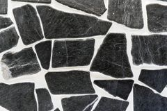 Background of natural black stones in the interior royalty free stock images