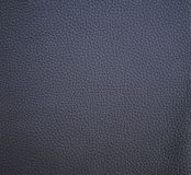 Coffee leather texture for background. Background from a natural leather color coffee. Suitable for backdrops, printing in high resolution and for any other of royalty free illustration