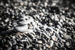 Background of natural pebble on a sea coast. Shallow depth of fi Stock Photography