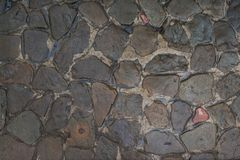 Background of natural stones. The road from the cobblestone. royalty free stock photography