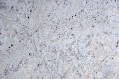 Background natural white stone with black dots, called granite Fantastic White.  royalty free stock images