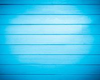Background of new natural wooden table blue color.  royalty free stock images