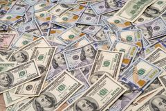 Background of 100 new and old dollar. Bills Stock Photography