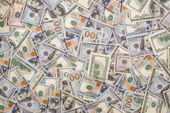Background of 100 new and old dollar. Bills Royalty Free Stock Images