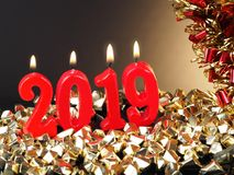 New Years Eve 2019. Background for New Years Eve, with lit red candles showing the number 2019 stock photo