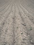 Background of newly plowed field ready for new crops - vintage e Royalty Free Stock Photos
