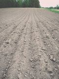Background of newly plowed field ready for new crops - vintage e Royalty Free Stock Image