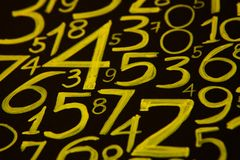 Background of numbers. from zero to nine. Numbers texture. Currency symbols. Numerology. Mathematical equations and formulas.  stock images