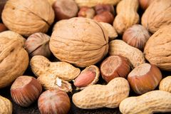 Background with nuts, in shell and peeled. Walnuts, hazelnuts and peanuts. Tasty healthy snack, food. Background with nuts, in shell and peeled. Walnuts stock photography