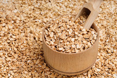 Background of oats in wooden bowl and scoop. Stock Images