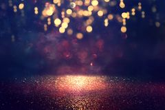 Free Background Of Abstract Glitter Lights. Gold And Black. De Focused Royalty Free Stock Photo - 161058525