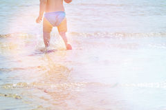 Free Background Of Blue Sea With Little Baby S Legs In Water. Holidays With Kids. Summer Beach. Adorable Child Can Be Boy Or Girl Royalty Free Stock Photo - 67095175