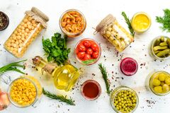 Free Background Of Food Stocks In Glass Jars. Pickled Vegetables And Mushrooms. Stock Photography - 183926312