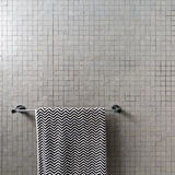 Background Of Mosaic Square Wall Tiles With Chevron Towel Royalty Free Stock Images