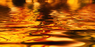 Background with oily liquid of different colors. Background with oily liquid of yellow colors Royalty Free Stock Photos