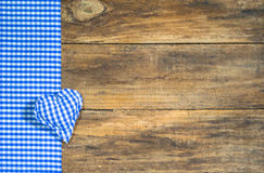 Background for Oktoberfest with heart in bavarian colors. Rustic background for Oktoberfest with bavarian blue and white colors and blue checked heart on old stock photo
